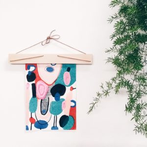Wooden 30cm Art Hanger holding a poster by Claire Johnson.