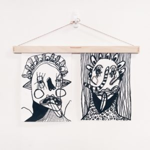Wooden 70cm Art Hanger holding two paintings by Claire Johnson.