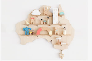 Australia Wooden Wall Shelf Treasure Board from One Two Tree Design decorated with kids toys.