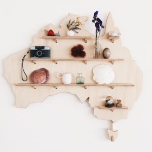 Australia Wooden Wall Shelf Treasure Board from One Two Tree Design decorated on a wall.