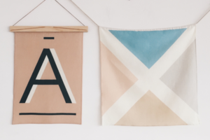 Linen Nautical Banner NE and Fawn Alphabet Print in A hangings in the wall.