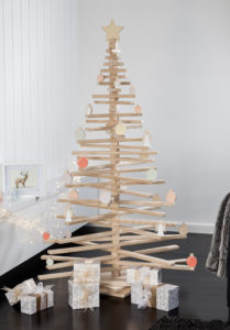 Wooden Christmas Tree with Star Topper and Ornaments in a Room - One Two Tree Designs