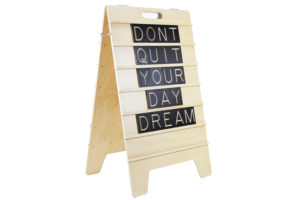 Don't Quit your Day Dream - Message Displayed on Wooden Sandwich Board by One Two Tree Designs