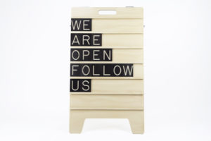 We are Open Follow Us - Message Displayed on Wooden Sandwich Board by One Two Tree Designs