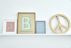 ABC Printed Alphabet Wall Decor with Wooden Peace Sign from One Two Tree Designs