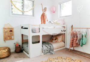 Kid Room Decorated with Play House Wall Shelf and Kids Toys